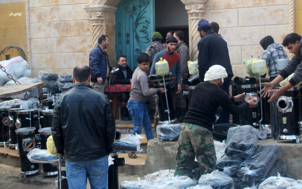 توزيع المدافئ وأدوات التدفئة في مدينة الباب