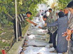 أطفال ضحايا مجزرة الغوطة (AFP)