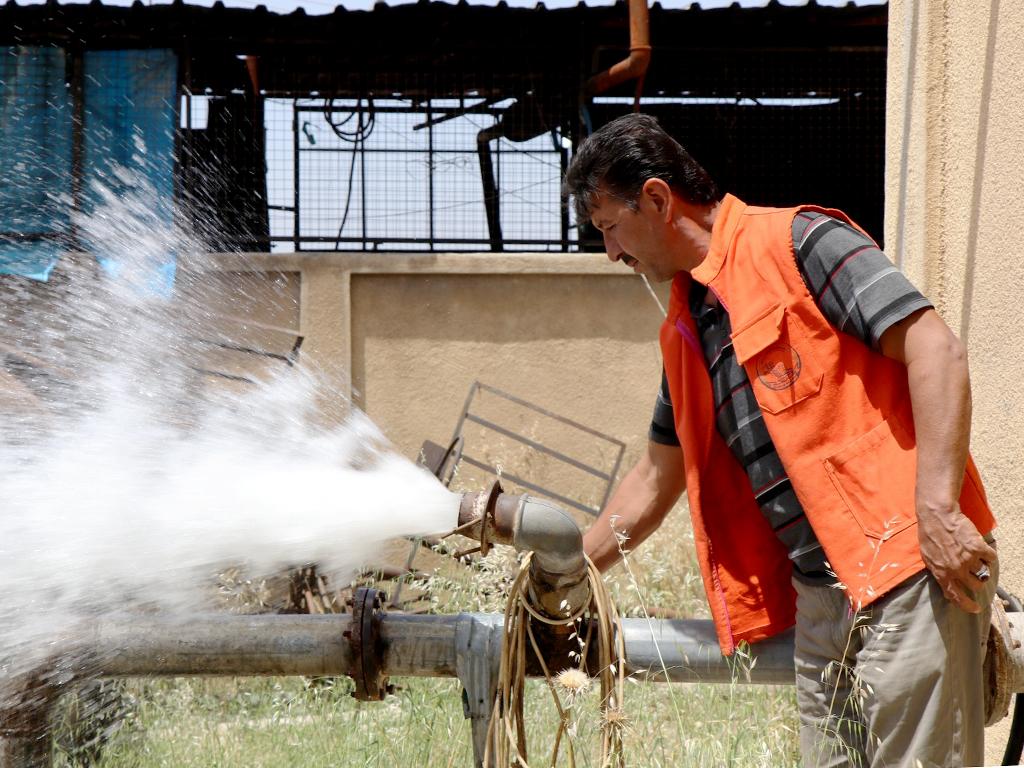 الصورة من مضخة مياه -لجنة إعادة الاستقرار