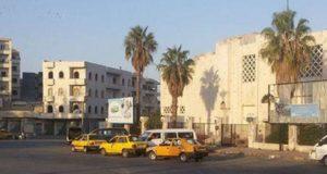 الصورة لسيارات أجرة قرب دوار المحراب في إدلب -إنترنيت