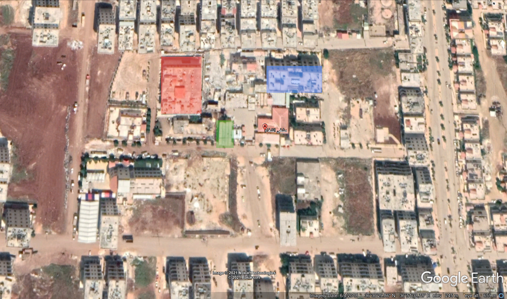 خريطة من غوغل إيرث تظهر مواقع الشرطة المدنية (بالأحمر) وفرع الأمن السياسي (بالأخضر) ومحكمة عفرين (بالأزرق) بالقرب من مشفى الشفاء المحدّد بالعلامة الحمراء